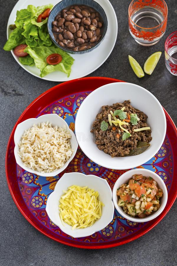 Mexican minced beef with rice, beans and salsa stock photos