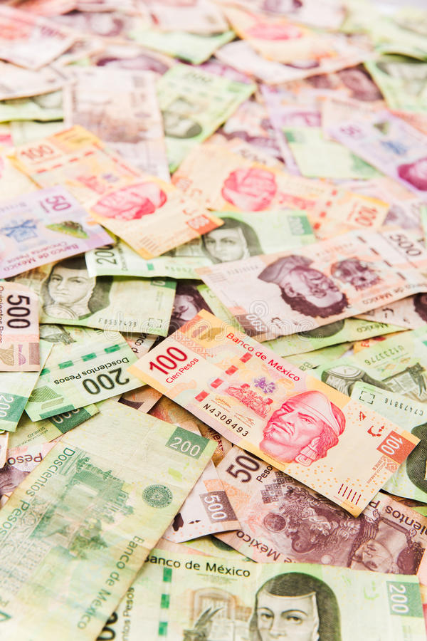 Mexican money background. Mexican pesos on bills of 50, 100, 200, 500 royalty free stock photo