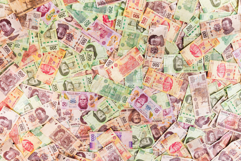 Mexican money background. Mexican pesos on bills of 50, 100, 200, 500 royalty free stock image