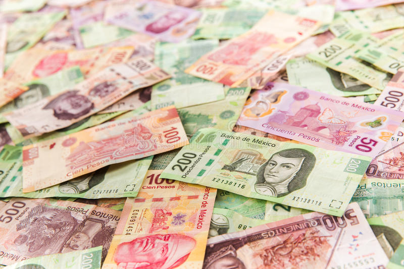 Mexican money background. Mexican pesos on bills of 50, 100, 200, 500 stock photography