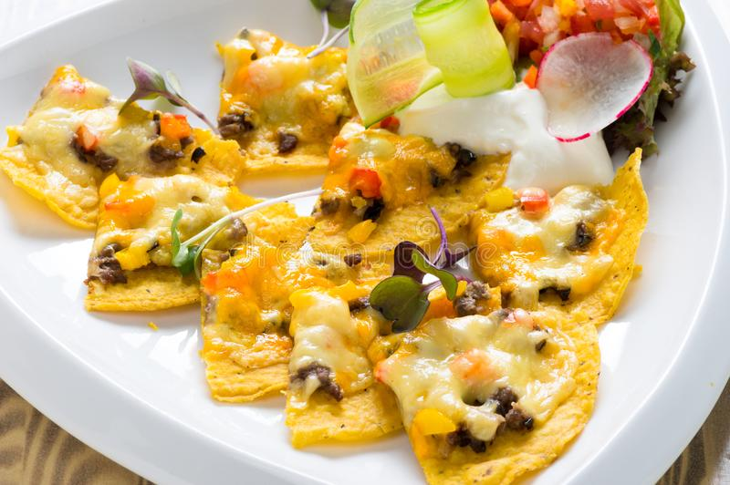 Mexican nachos with cheese stock photos