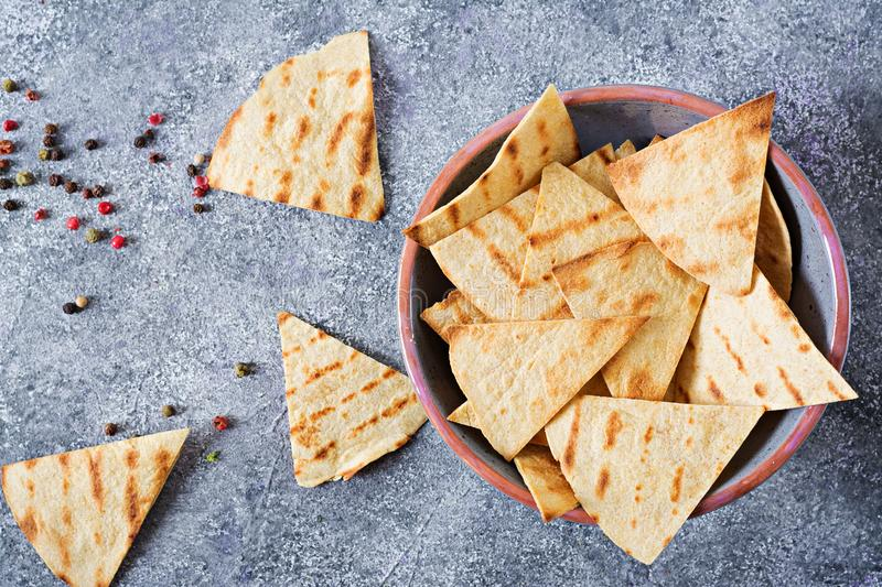 Mexican nachos on a light background. On the grey plate. Top view royalty free stock images