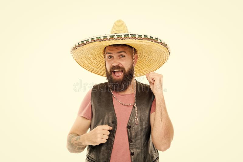 Mexican party concept. Guy happy cheerful festive outfit ready to celebrate. Mexican melody drives him. Man bearded. Cheerful guy wear sombrero mexican hat royalty free stock photo