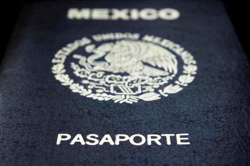 Mexican passport in a black background. Front face of a Mexican passport. Black background royalty free stock image