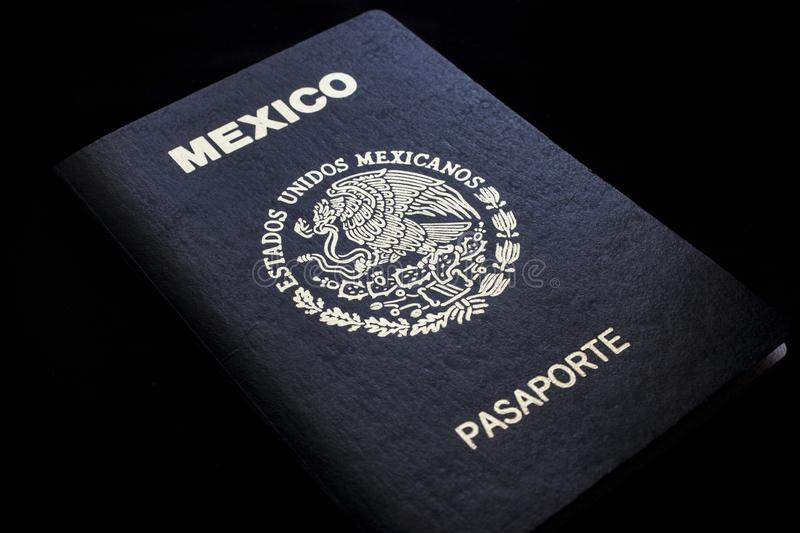 Mexican passport in a black background. Front face of a Mexican passport. Black background stock images