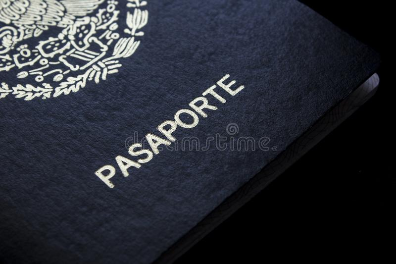 Mexican passport in a black background. Front face of a Mexican passport. Black background royalty free stock photography