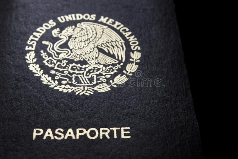 Mexican passport in a black background. Front face of a Mexican passport. Black background stock photo