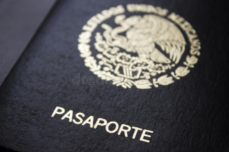 Mexican passport in a black background. Front face of a Mexican passport. Black background stock image