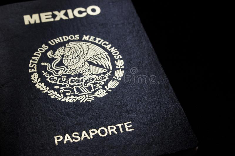 Mexican passport in a black background. Front face of a Mexican passport. Black background stock photos