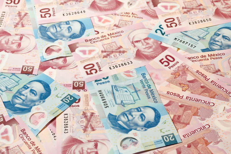 Mexican pesos. Background of Mexican pesos - 20 and 50 pesos bills royalty free stock image
