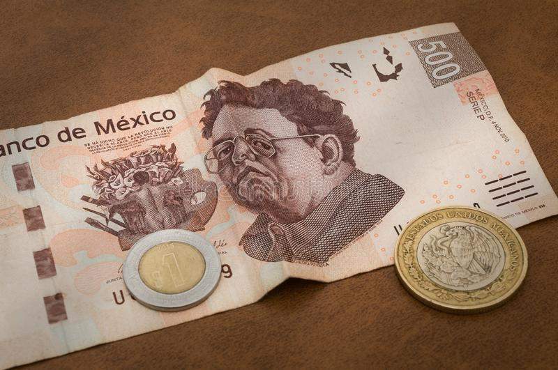 A 500 mexican pesos bill seems to be sad. stock photography