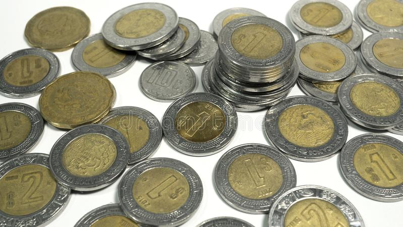 Mexican pesos, old and damaged Mexico coins royalty free stock photo
