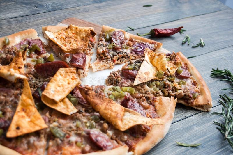Mexican pizza with meat and Peppers on a wooden table royalty free stock photo