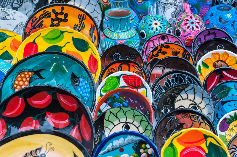 Mexican Plates. Colourful Mexican Pottery Plates in the Market stock photos