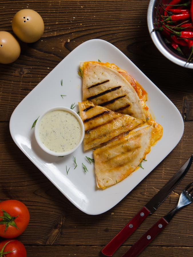 Mexican quesadilla with chicken, cheese and peppers royalty free stock photo