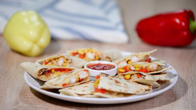 Mexican quesadilla with chicken, cheese and peppers on wooden table. royalty free stock image