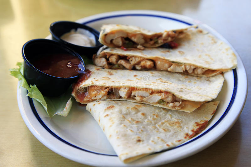 Mexican Quesadilla. With chicken and two sauces stock photo