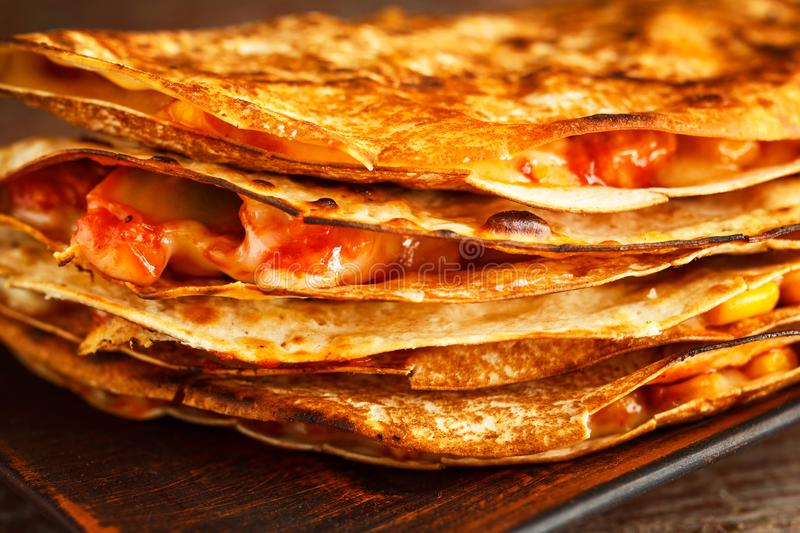 Mexican quesadilla closeup on a plate on a wooden table. stock images