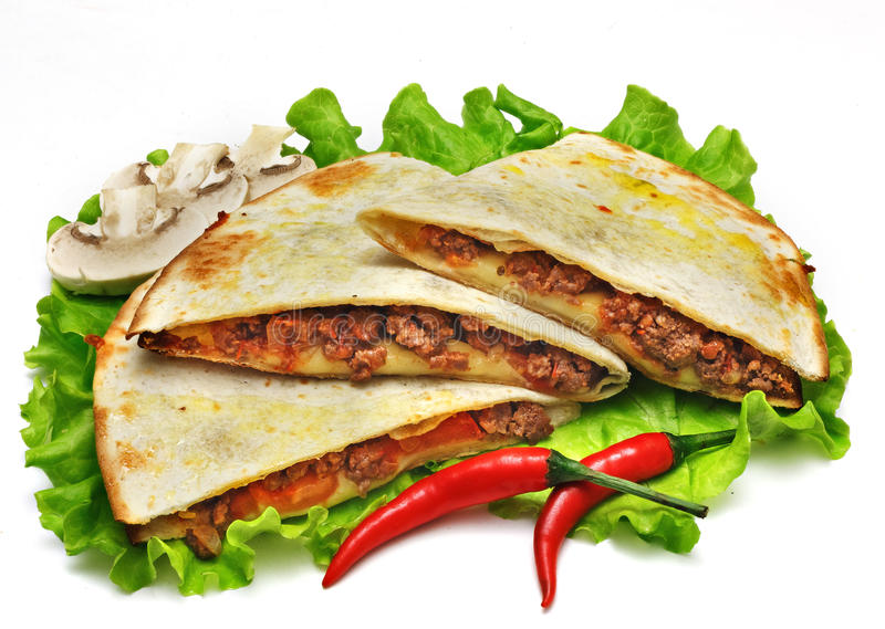 Mexican quesadillas with cheese, vegetables and salsa isolated. On a white background royalty free stock photography