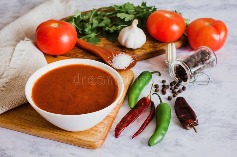 Mexican red sauce, spicy hot chili sauce made with chilli pepper, garlic and tomatoes, food in Mexico stock photo