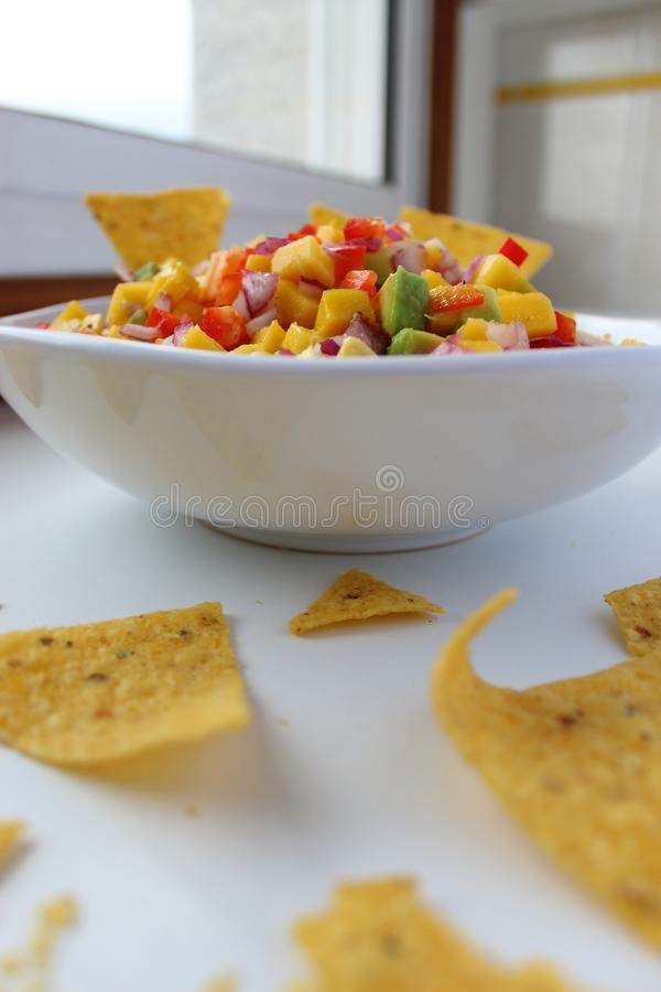 Mexican salsa dip with nachos chips. royalty free stock image