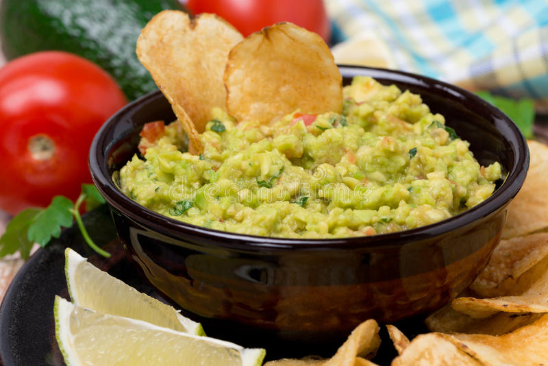 Mexican sauce guacamole and chips. Close-up stock photos