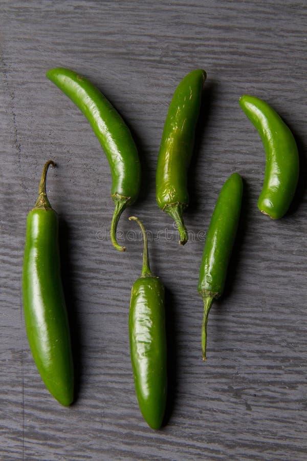 Serrano chili pepper. Mexican serrano chili pepper on grey background stock photo