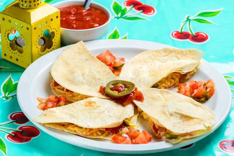 Mexican sincronizada with ham and cheese. Macro close up of appetizing Mexican quesadillas with ham and cheese stock photography