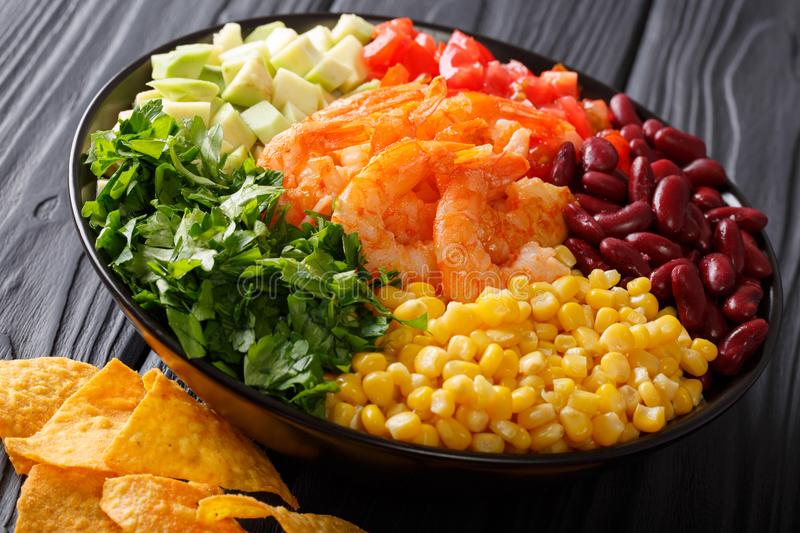 Mexican snack: burrito bowl with shrimp and vegetables close-up. horizontal royalty free stock images