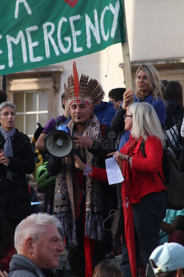 Mexican Speaker at Extinction Rebellion Protest With traditional headress royalty free stock images