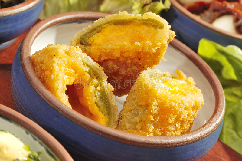 Mexican speciality Jalapenos w cheddar stock photos