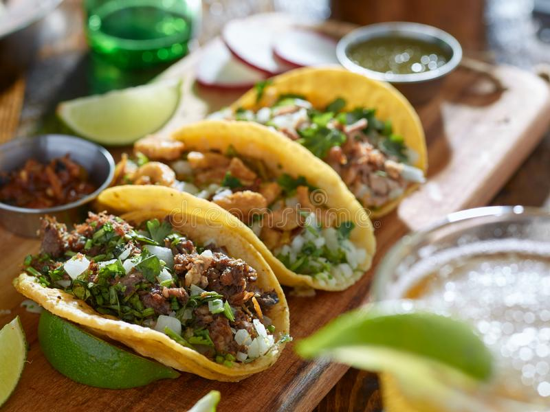 Mexican street tacos in yellow tortilla with beef and pork stock photography