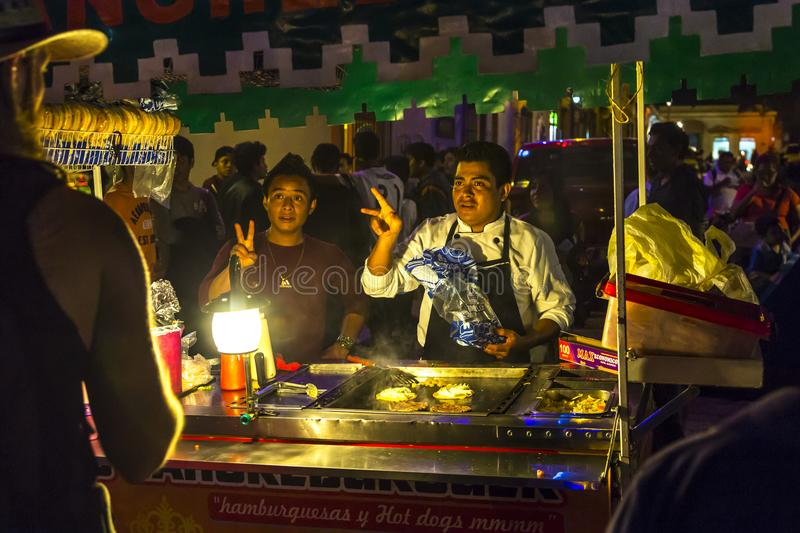Mexican Street Vendor. S take food orders during night activities in Oaxaca City, Mexico stock images