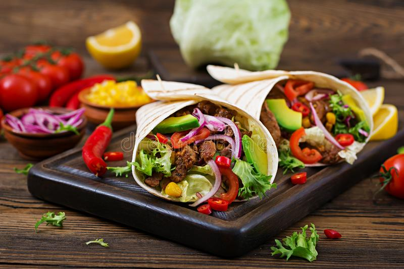 Mexican tacos with beef in tomato sauce stock photo