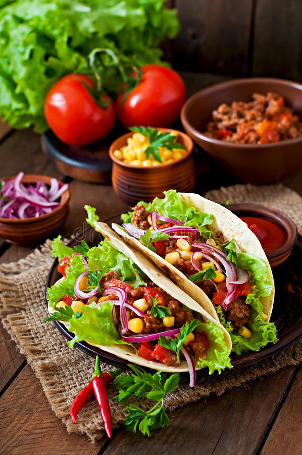 Mexican tacos with meat, vegetables royalty free stock photos