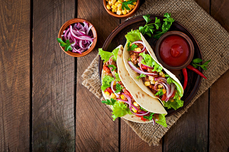 Mexican tacos with meat, vegetables royalty free stock photo