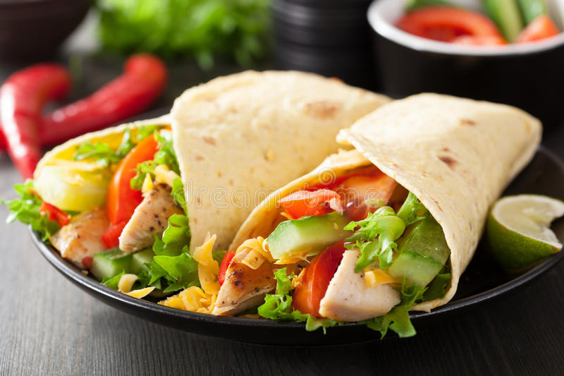 Mexican tortilla wrap with chicken breast and vegetables royalty free stock photography