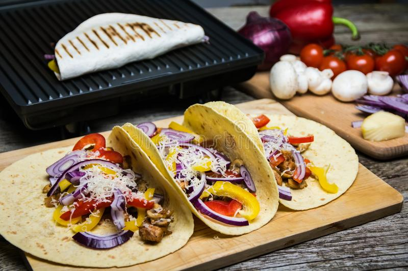 Mexican tortilla wrap with vegetables royalty free stock photo
