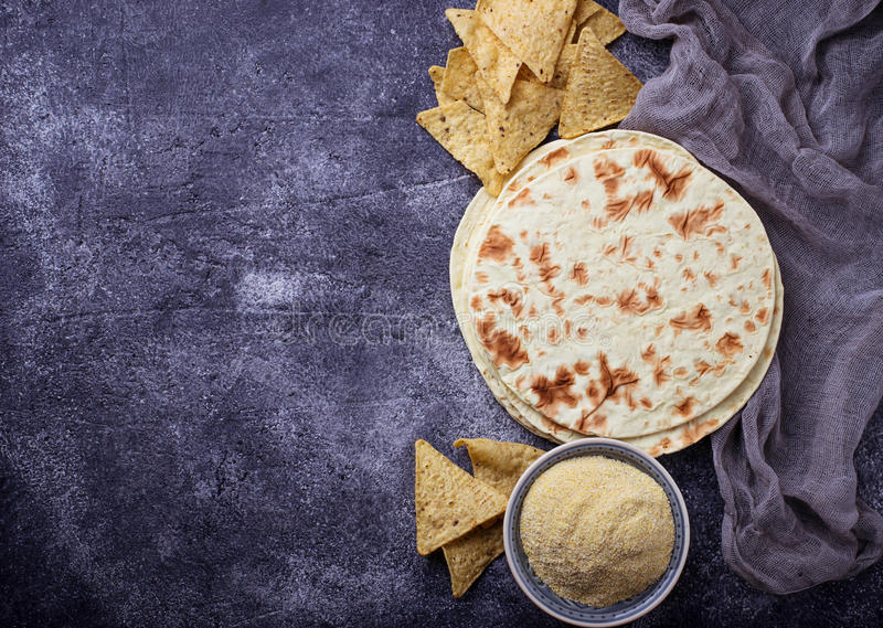 Mexican tortillas, nacho chips and corn flour royalty free stock image