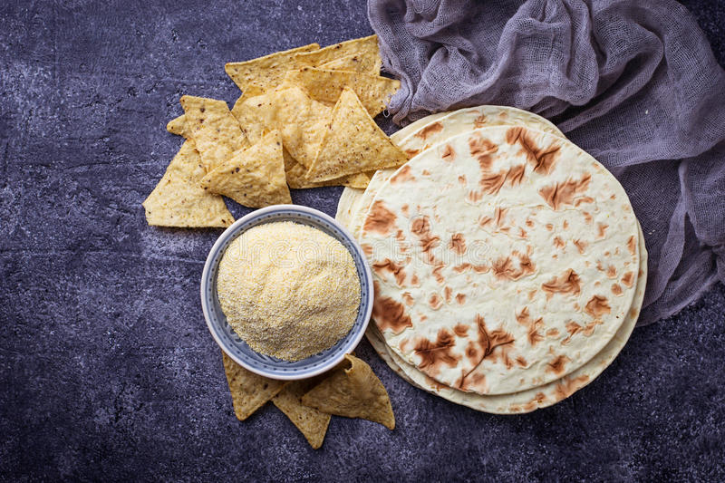 Mexican tortillas, nacho chips and corn flour stock images