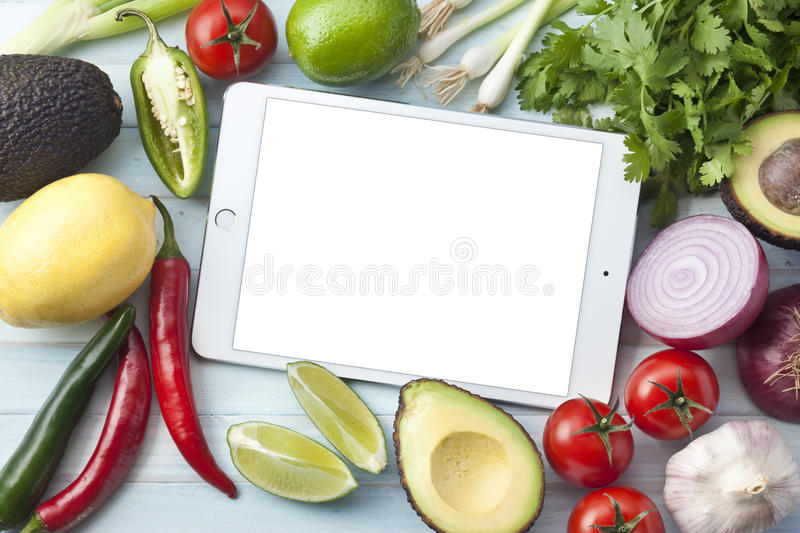 iPad Tablet Mexican Vegetables Wood Background royalty free stock image