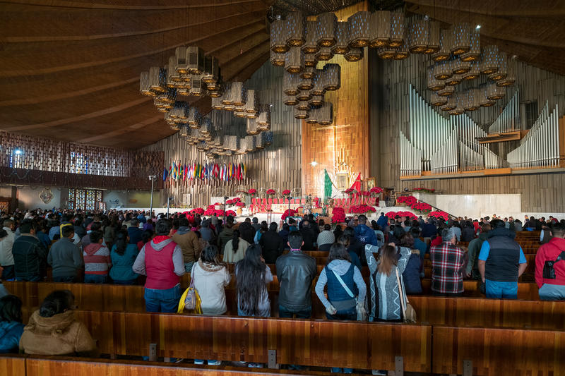 Mexicans getting ready for an early morning mass at the Basilica of Guadalupe royalty free stock image