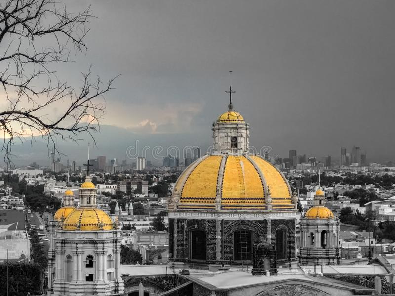 Mexico City cityscape with Expiatory Temple to Christ The King. Urban landscape. Yellow colors isolated on temple domes and clouds stock photo
