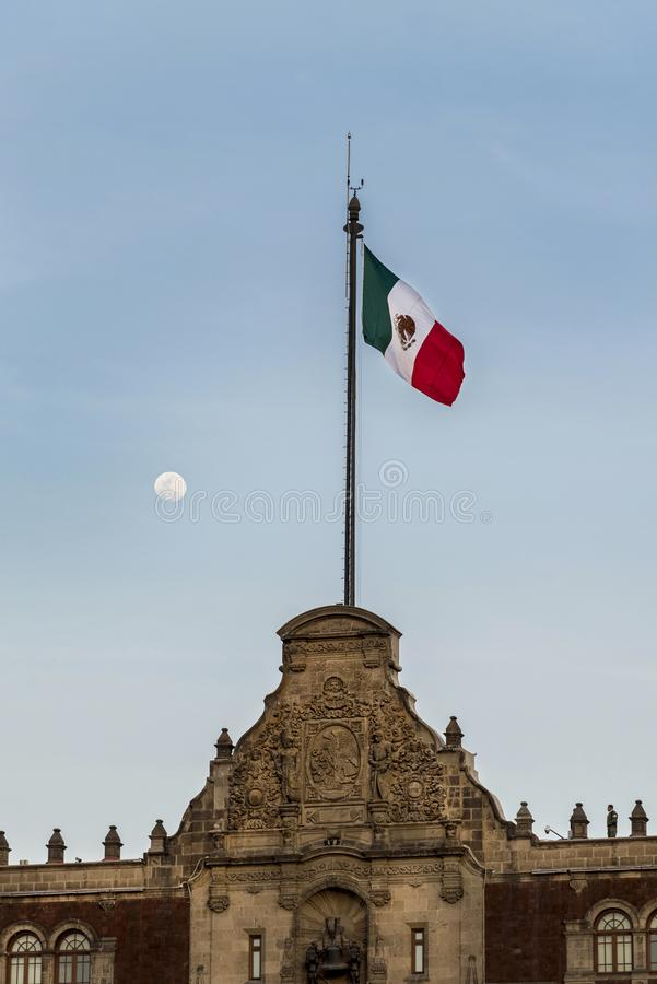 Mexico City, flag and moon on the background,zocalo. Mexico City, government building with flag and moon on the background,town square royalty free stock images