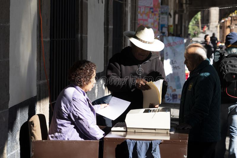 MEXICO CITY, MEXICO - JANUARY 30 2019 - Santo Domingo Place. Scribes with typewriters and antique printing machines work in this Portal offering their services stock image