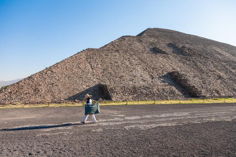 Merchant walks by the Pyramid oа the Moon early in the morning stock photo