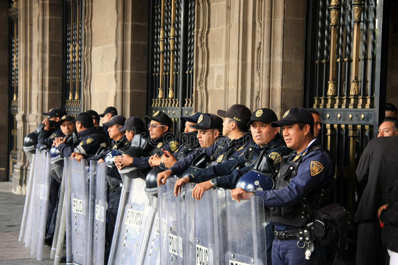 Mexico City, Mexico - November 24, 2015: Mexican Police Officers in Riot Gear outside building in Zocalo Square, Mexico City. Mexican Police Officers in Riot stock photos