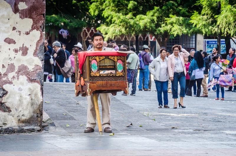 Mexico City, Mexico - October 26, 2018. Mexican playing on barrel organ stock photos