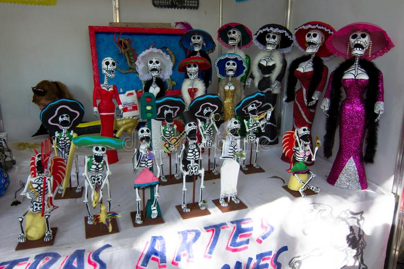 Catrina dolls are displayed for sale as celebration of the day of the dead in Mexico City stock image