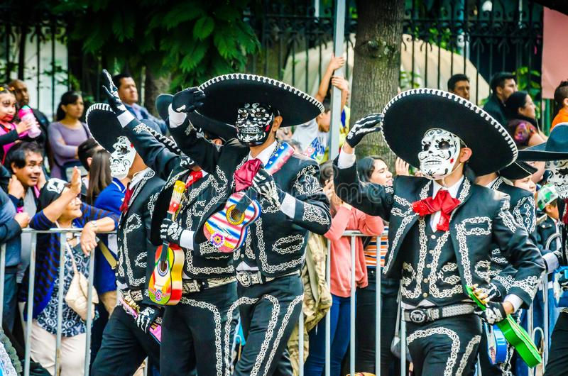 Mexico City, Mexico - October 27, 2018. Celebration of Day of Dead parade, Dia de los Muertos desfile - mask parade stock photos